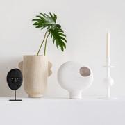 Kerzenhalter aus recyceltem Milchglas